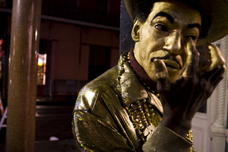 """Goldie of Bourbon Street"" applies his make up before wandering the streets of for tips."